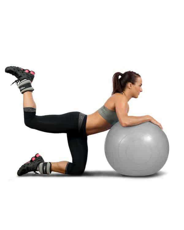 woman with stability ball and ankle weights