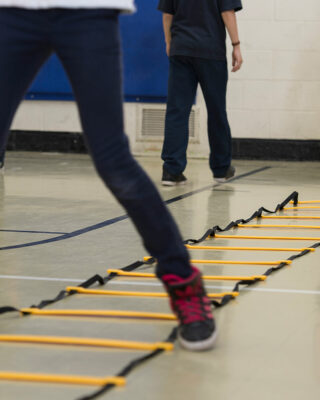 Close up of child using agility ladder