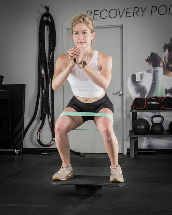 COREFX Wobble Board girl squatting