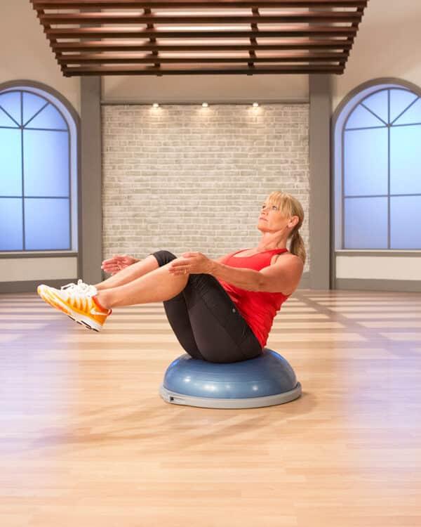 Woman sitting on BOSU Balance Trainer Pro