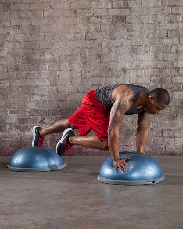Man working out with two pro balance trainers