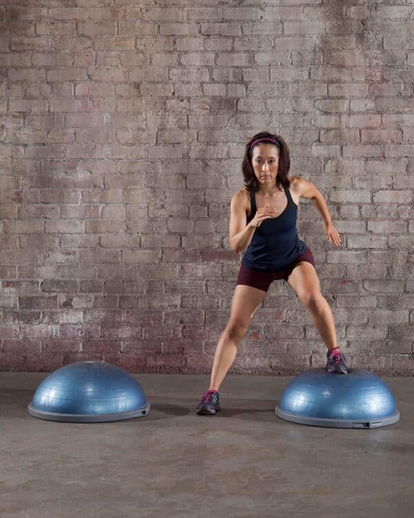Woman cardio workout using the BOSU Balance Trainer Pro