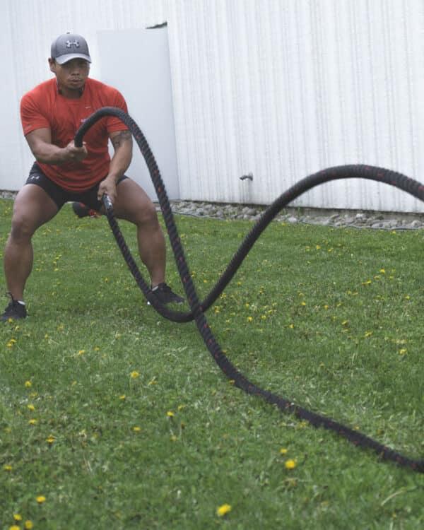 male using COREFX Battle Rope outside