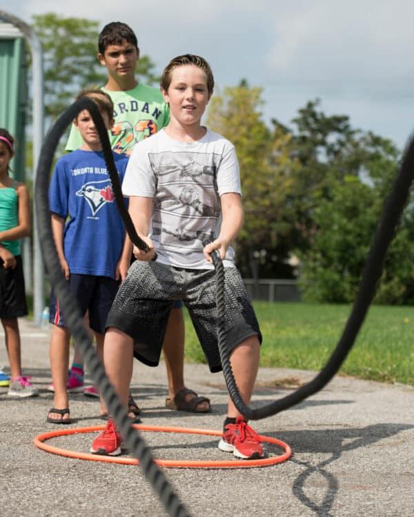 schoolyard children with junior battle rope