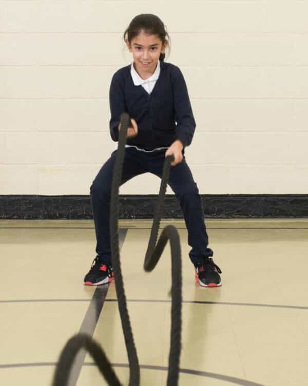 girl exercising with kidfit junior battle rope