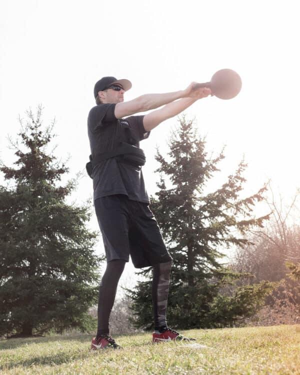 Man doing kettlebell swing workout