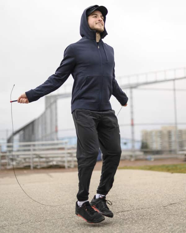 COREFX Thin Grip Speed Rope male jumping outside