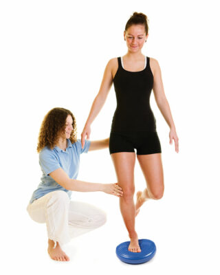 Physiotherapist assisting with Wobble Disk