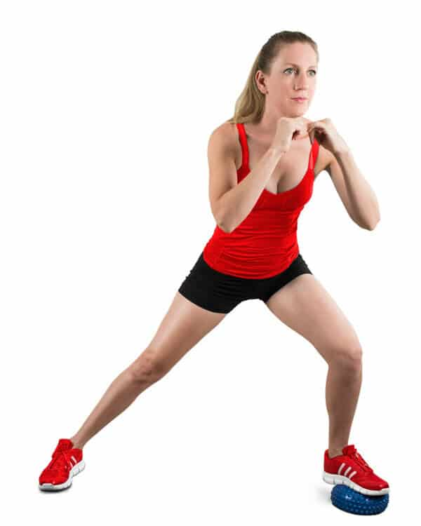 Woman doing side lunges with a balance pod