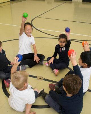 Kids Holding UltraSkin Balls