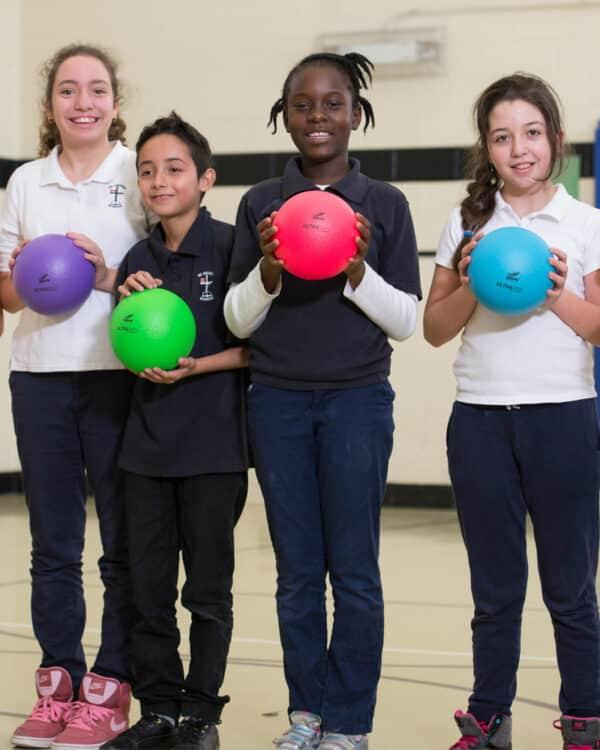 Kids Holding Neon Ultraskin Balls