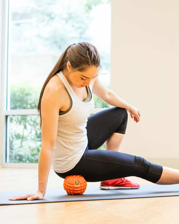 Woman recovering with TriggerPoint GRID Ball