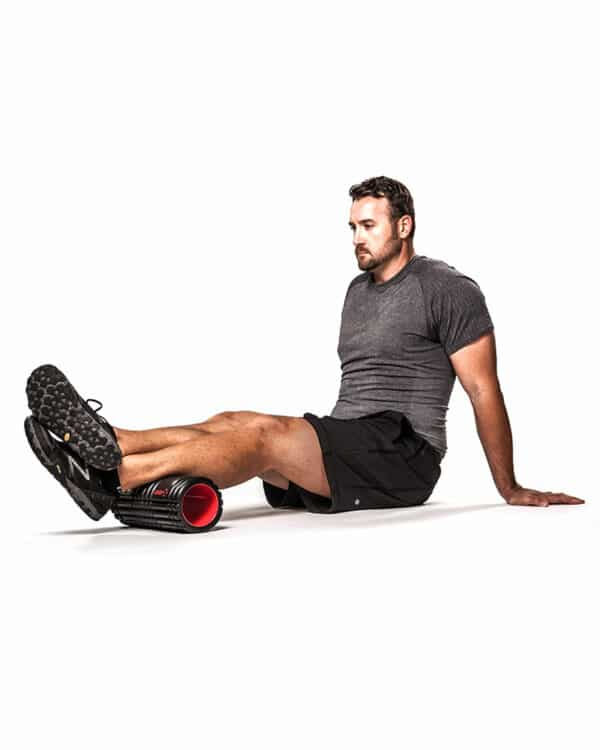 Man rolling out calf muscles with GRID X
