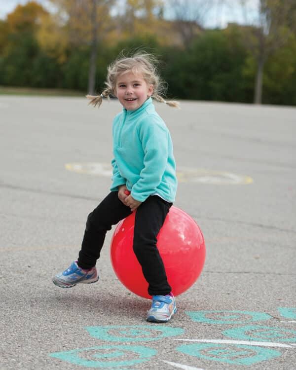playground child with hop ball