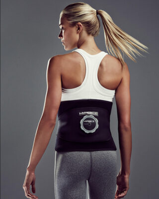 Woman wearing Hyperice Ice Compression Back Wrap