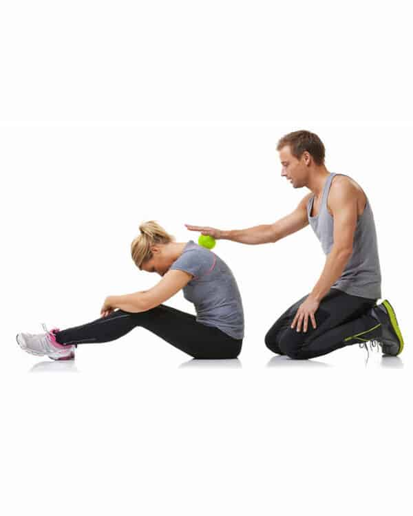 Man massaging woman's back with the Concorde Massage Ball