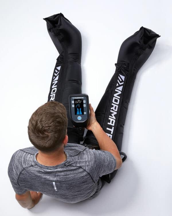 Man using Normatec Pulse 2.0 Legs