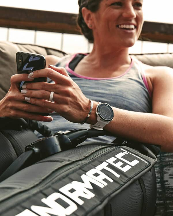 Woman recovering with NormaTec Pulse 2.0 Legs