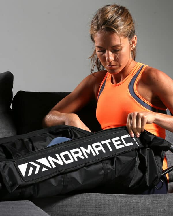 Zipping up Normatec Pulse 2.0 Legs