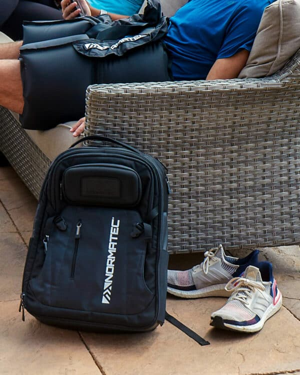 NormaTec Backpack leaning on floor