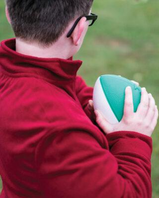 Boy using Mini Coated Foam Footballs