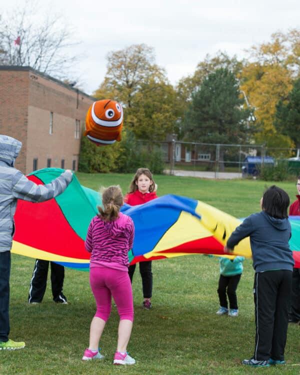 multi-coloured parachute on playground