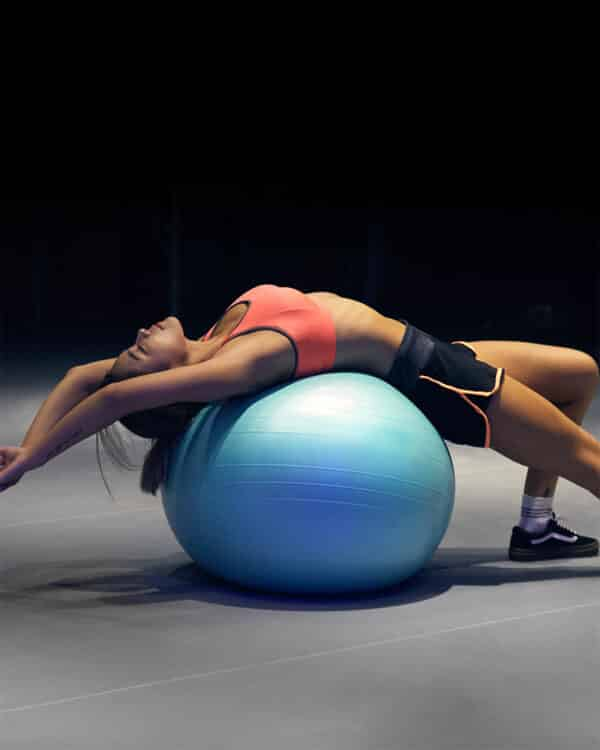 Woman stretching on stability ball