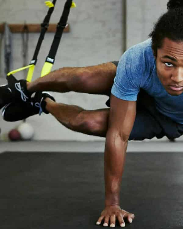 athlete with home suspension trainer