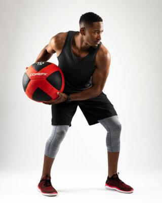 Athlete using the COREFX 10 pound Wall Ball
