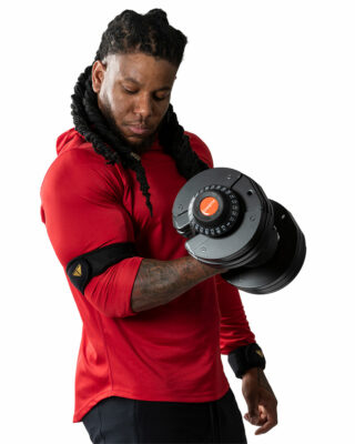 Man doing bicep curl with Adjustable Dumbbell Set