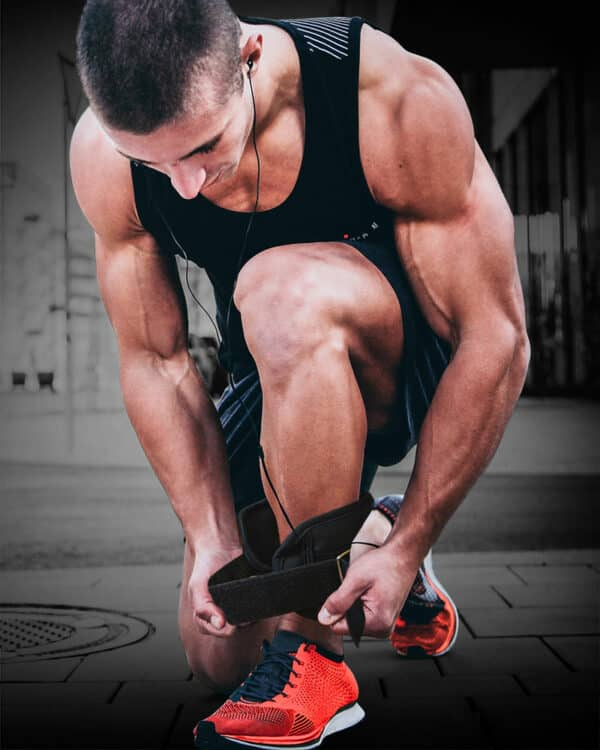 Man doing up COREFX ankle weights