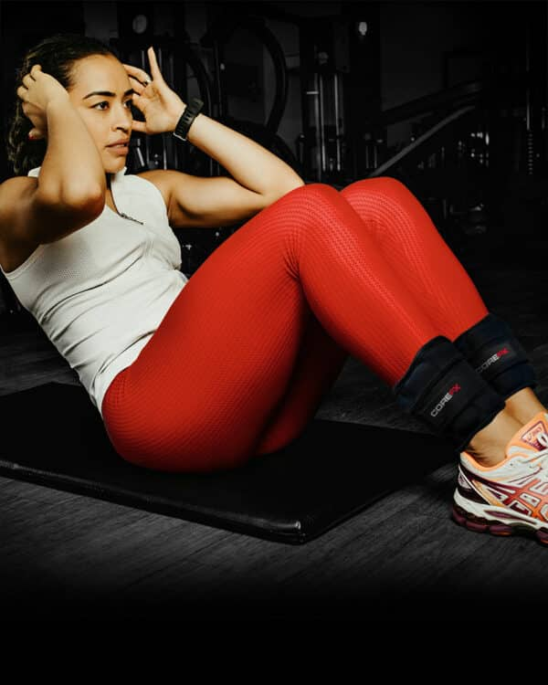 Woman workout out with COREFX Ankle Weights