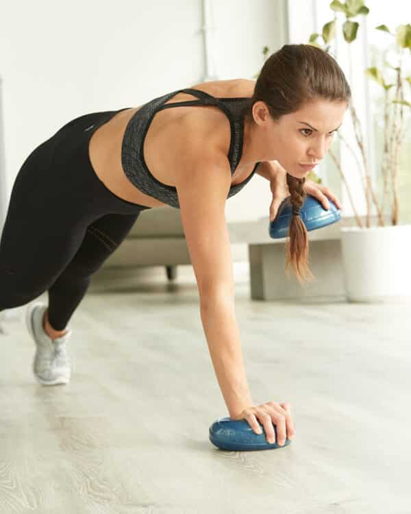 Woman working out with BOSU® Balance Pods