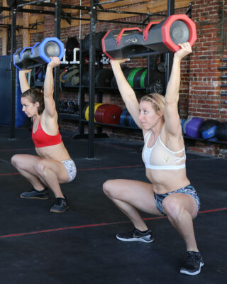 Two women squatting with surge