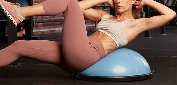 Woman exercising with BOSU Balance Trainer